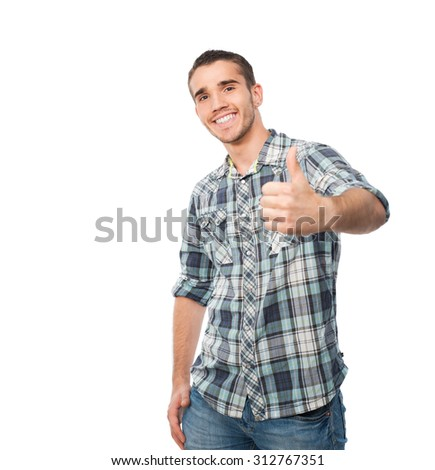 young man standing in front of camera showing thumb up sign - stock photo