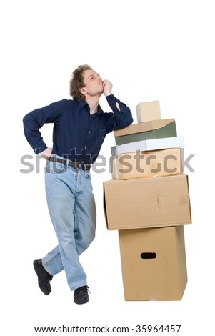 young man standing near pile of boxes leaned his elbow on it