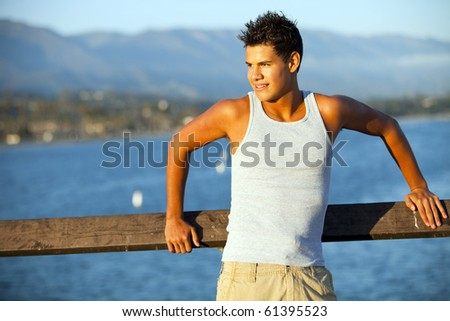 Young man standing on the pier - stock photo