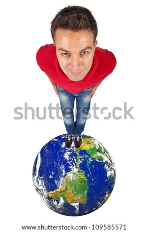 young man standing on top of a globe - elements of this image furnished by NASA - stock photo
