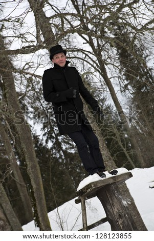 Young man standing on wooden stage before jump