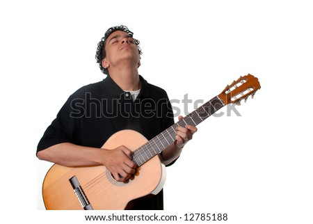 Young Man Standing Playing An Acoustic Guitar