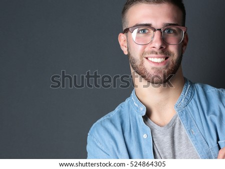 Young man standing with handbag isolated on white background