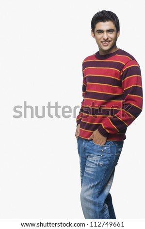 Young man standing with hands in the pocket - stock photo