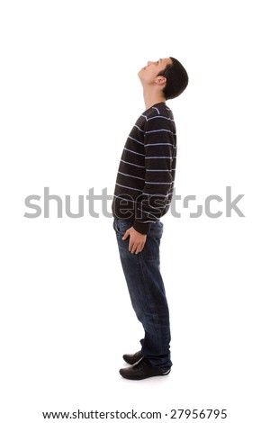 young man standing with his head looking up (isolated on white) - stock photo