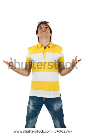 Young man standing with open hands  and looking up ,meditating isolated on white background - stock photo