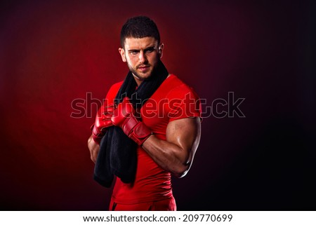 young man standing with towel around his neck - stock photo
