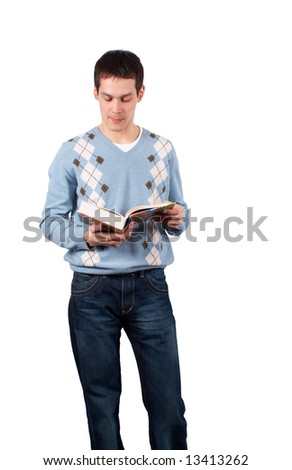 Young man stands and read book isolated on white