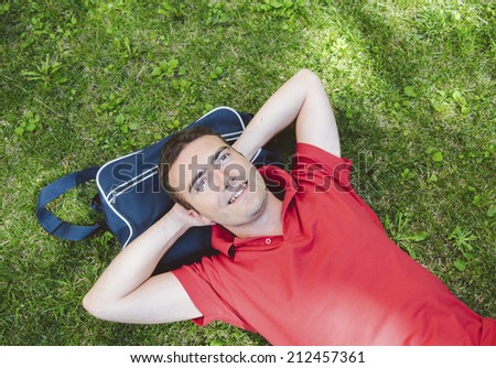 young man student relaxing and wondering about the future - stock photo