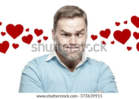 Young man suffering from headache and stress with hearts - a symbol of Valentine's Day, isolated - stock photo