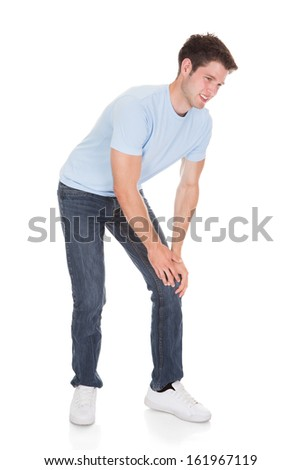 Young Man Suffering From Knee Pain Isolated On White Background - stock photo