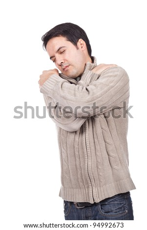 young man suffering from shoulder pain - stock photo