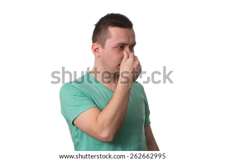 Young Man Suffering From Sinus Pressure Pain - Isolated On White Background - stock photo