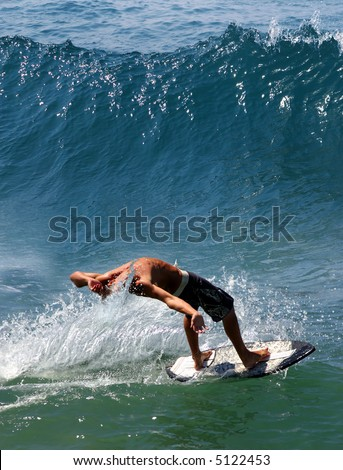 Young man surfing in California - stock photo