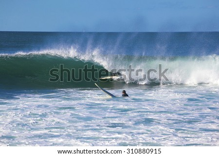 Young man surfing in Cronulla - stock photo