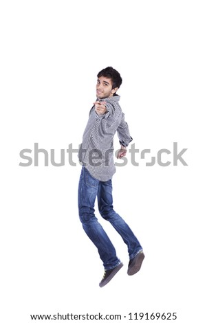 young man surfing the internet in his laptop sited on the carpet (isolated on white) - stock photo