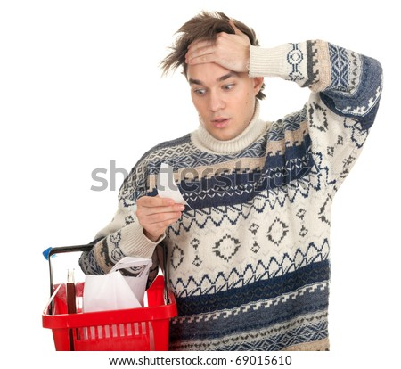 young man surprised expression looking at store receipt - stock photo