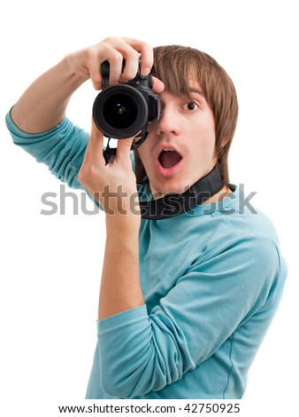 Young man surprised with photo camera. Front view. Isolated on white - stock photo