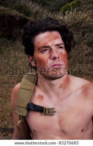 Young man sweating as he rests in military gear - stock photo