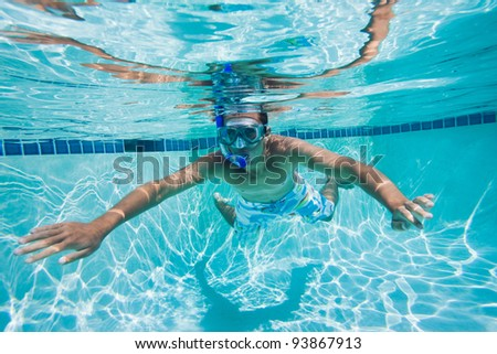 Young Man Swimming Under Water In Pool - stock photo