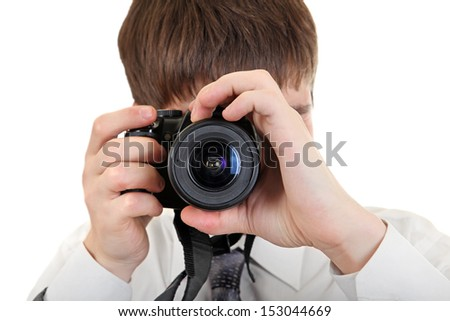 Young Man Take a Picture with a Camera Isolated on the White Background