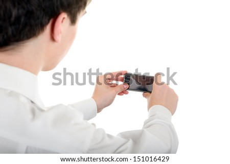 Young Man take a Picture with a Cellphone Isolated on the White Background - stock photo
