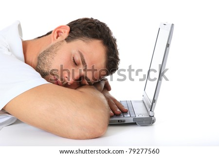 Young man taking a nap on his laptop. All on white background. - stock photo