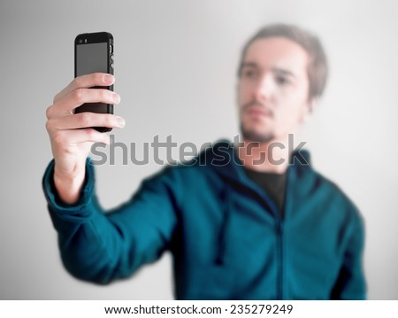 Young man taking a selfie photo. Isolated - stock photo