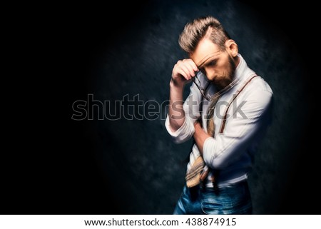 Young man taking off his glasses - motion blur - stock photo