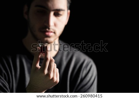 Young Man Taking The Lords Supper - stock photo