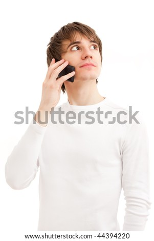 Young man talking by mobile phone. Light picture - stock photo