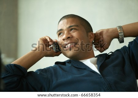 Young man talking on cell phone - stock photo