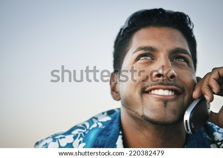 Young man talking on his cell phone - stock photo