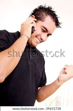 Young man talking on his mobile phone to receive good news - stock photo