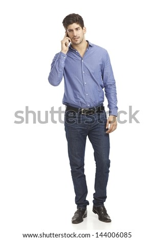 Young man talking on mobilephone. Full size. - stock photo