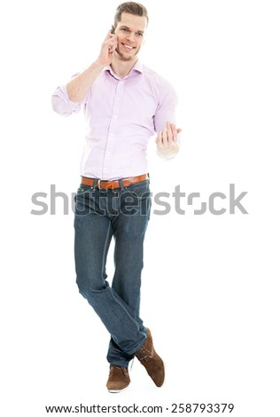 young man talking on the phone - full length shot isolated - stock photo