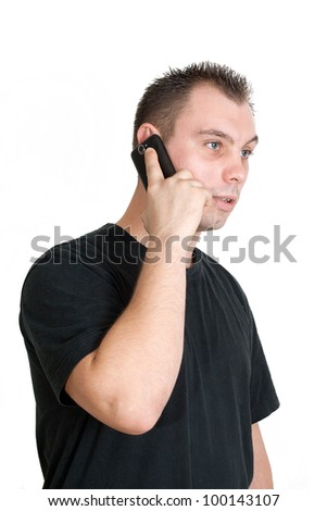 young man talking to someone with his cellphone - isolated on white background