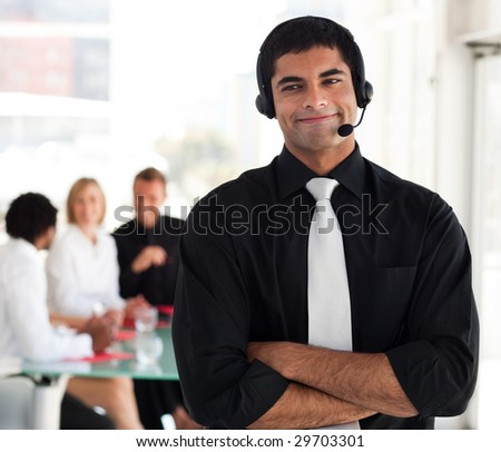 Young man talking with a headset on