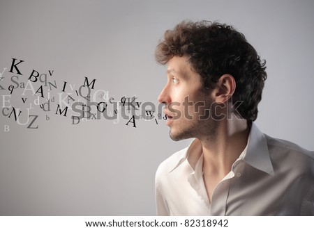 Young man talking with alphabet letters coming out of his mouth - stock photo