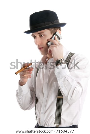 young man talks by a mobile phone and holds cigar. Isolated on white background
