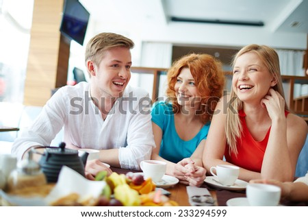 Young man telling something to his friends - stock photo