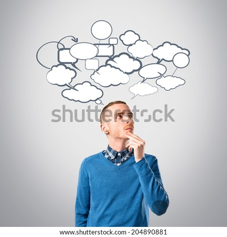 Young man thinking over grey background  - stock photo