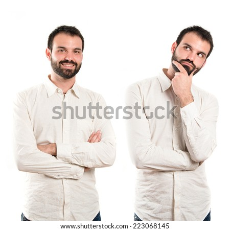 Young man thinking over white background - stock photo