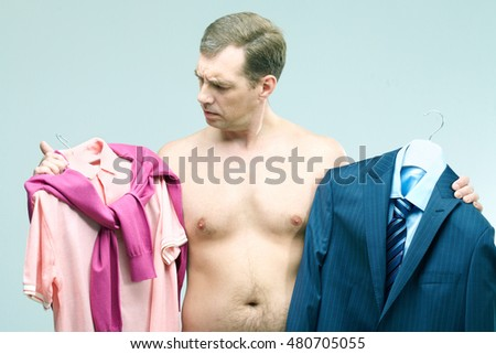 Young man thinking what to wear