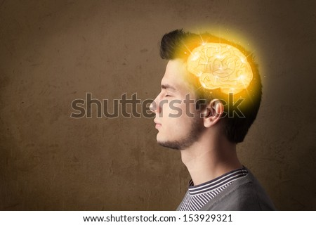 Young man thinking with glowing brain illustration - stock photo