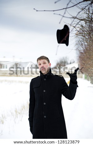 Young man threw hat in air for fun