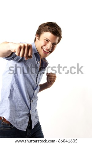 Young man throwing a punch - stock photo