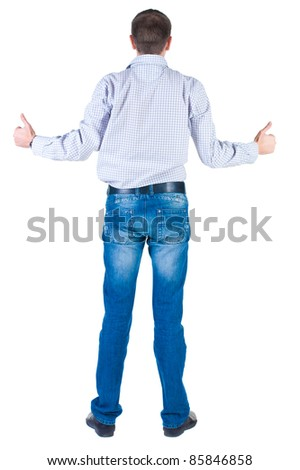 Young man thumbs up. rear view. Isolated over white .