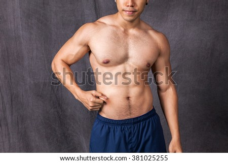 Young man training body, Dieting, Abdomen.
