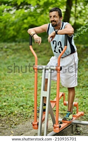 Young man training on sport equipment outside - stock photo